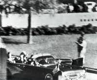 At 12:30 p.m., the motorcade with President John F. Kennedy travels down Elm Street right before he is struck by bullets. Abraham Zapruder captured the president's assassination in his home movie, which would later fuel conspiracy theories after its release to the public.(Abraham Zapruder - Life Magazine)