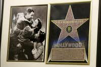 """In this photo made on Friday, Dec. 20, 2013, a framed plaque with a photograph of a scene from the 1946 film """"It's A Wonderful Life"""" starring Jimmy Stewart, left, and a Hollywood star are on display at the Jimmy Stewart Museum in Indiana, Pa."""