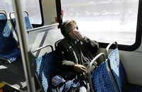 Artis Frank rubs his face during the last leg of his commute on a DART bus.( Nathan Hunsinger  -  Staff Photographer )
