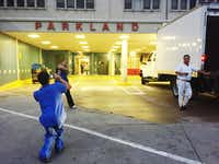 Employees posed  for photos outside the entrance to the emergency room at the old Parkland on Thursday.(Naheed Rajwani - Staff)