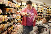 Janette read the labels on breakfast meats while grocery shopping with Jonathan shortly after he got out of the hospital in February. Jonathan was weak and didn't feel up to walking around the store, so he rode in a motorized cart.