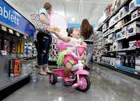 As her mother shops, Kamila Coronado, 1, is dazzled by the electronics on the shelves of an H-E-B Plus store in Waco.( File 2013  -  Waco Tribune Herald )