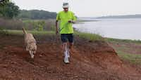 Jack Milligan and Daisy take yet another stroll together.(David Woo/Staff Photographer)