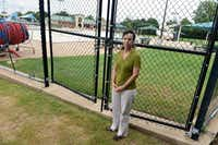 Amy Fortenberry, director of Parks and Recreation for the city of Plano, stands outside a locked gate at Jack Carter Pool in Plano. Although the pool, built in 1981, was recently renovated, it leaked as much as 3 feet of water a day in the fall.(Rose Baca - neighborsgo staff photographer)