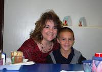Principal Hill stopped by the cafeteria to say hello to her son, Jackson. Both of Hill's kids attend Stonewall this year.(Staff photo by ANANDA BOARDMAN)