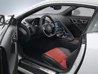 Space in the  two-seat Jaguar F-Type coupe is at a premium — but you can always use the rear hatch for storage.(Jaguar)