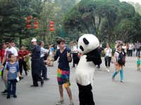 Lake Highlands High School graduate Jake Gaba dances with a man in a panda suit in Chengdu, China. This scene was included in a video Gaba produced of himself dancing in various locations around the country during his study abroad trip last fall.(Photos submitted by JAKE GABA)