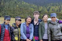 Lake Highlands High School graduate Jake Gaba poses with Tibetan women after filming a sequence of the video of himself dancing across various locations from the Great Wall of China to the serene lakes of Tibet.Photo submitted by JAKE GABA