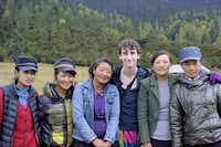 Lake Highlands High School graduate Jake Gaba poses with Tibetan women after filming a sequence of the video of himself dancing across various locations from the Great Wall of China to the serene lakes of Tibet.(Photo submitted by JAKE GABA)