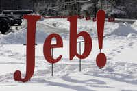 A Jeb! sign is set in a  snowbank at a school where Jeb Bush campaigned on Feb. 6, 2016, in Bedford, N.H. (AP/Jim Cole)