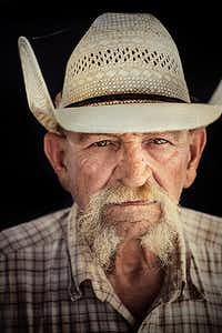 "Wagon Boss Jimbo Glover Waggoner Cowboy since 1975 Jimbo Glover came to the Waggoner Ranch in 1976 and has called the shots as wagon boss for twenty-two years. He likes the solitude a cowboy enjoys. ""I've always been quiet and much to myself."" It seems natural that he would be a cowboy. ""Aw,"" he says, ""I just grew up being that way."" Cowboys work ten hours a day, five and a half days a week. ""There's always enough cowboys around for an emergency, like fighting a grassfire or something,"" says Jimbo Glover. ""Somebody asked me, 'What do you want to be when you get big?' and I said, 'I ain't going to be a fireman, I'll tell you.'"""