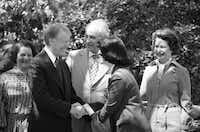 President Jimmy Carter greets Luci Johnson Nugent, youngest daughter of the late President and Mrs. Lyndon Johnson, during Carter's visit to Dallas, March 25, 1979. President Johnson's widow Lady Bird is at the right and host Special Trade Ambassador Robert Strauss is at center. The president was in Dallas to address the National Association of Broadcasters convention and paid a brief visit to the Strauss home.(DS -  ASSOCIATED PRESS )