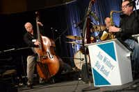 Widner, a close friend and mentee of John Worster, plays Worster's old bass during a sound check at the Hyatt Regency Dallas. Due to a loss of voluntary muscle control, Worster sold his bass for $500 to Widner, who said it dates back roughly 200 years. In a few years, Widner plans to give the bass to Worster's son, Damian, also a musician  252ROSE BACA