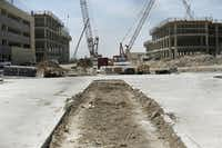 When the 1,200 construction workers  are finished with their jobs — including pouring 500 truckloads of concrete in one week — at the campus in Plano, it'll be time for 4,000 Toyota employees to move in.Andy Jacobsohn - Staff Photographer