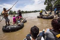 Migrants raft across the Suchiate River from Guatemala to Mexico, landing near Ciudad Hidalgo. Informal crossings have long been tolerated.(Meridith Kohut - The New York Times)