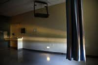 A hospital room lies vacant inside the now-closed Renaissance Hospital Terrell. Nursing breakdowns led to three patient deaths there, inspectors found, and the facility was padlocked over unpaid property taxes.