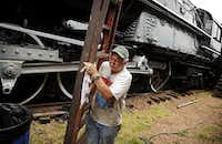 Dick Thompson helps prepare the museum's Big Boy — the world's largest and most powerful steam locomotive — for its move to Frisco.G.J. MCCARTHY / STAFF PHOTOGRAPHER