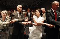 "Social activist Julian Bond and Luci Baines Johnson join in as the crowd sings ""We Shall Overcome"" at the Civil Rights Summit. Three former presidents — George W. Bush, Jimmy Carter and Bill Clinton — were also among attendees at the summit.( Vernon Bryant  -  Staff Photographer )"