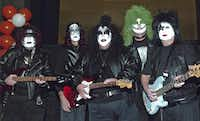 De Pierce (left), Jeff Isom, Alan White, Jerry Schaffner and George McCleskey were KISS in a 2005 companywide Halloween tour of Lubbock, Austin and Dallas. Costumes are mandatory for all 4,500 employees of PlainsCapital Corp.Dana Driensky