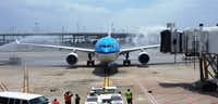 A KLM jet is welcomed to Dallas/Fort Worth International Airport in this May 2013 photo. (Terry Maxon/DMN)