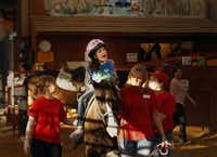 """Kaitlyn Samuels, center, rides on a horse called """"Uno"""" in her physical therapy session at Rocky Top Therapy Center in Keller in January 2013. (Kye R. Lee/Staff photographer)"""