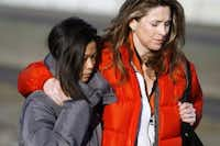 FILE PHOTO: Karen James, right, wife of Kelly James, and Michaela Cooke, (left) wife of Jerry Cooke, support each other following a news conference Sunday, Dec. 17, 2006 at the airport in Hood River, Ore., about their husbands, who went missing while climbing Mount Hood. (AP Photo/The Oregonian, Faith Cathcart)