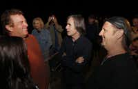 Kelcy Warren (left), CEO of Energy Transfer Partners, talked with musicians Jackson Browne and Jimmy LaFave backstage after Browne's show last year at the Cherokee Music Festival in Cherokee, Texas.
