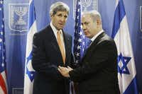 Secretary of State John Kerry, meeting with Israeli Prime Minister Benjamin Netanyahu, also visited with Mahmoud Abbas, the Palestinian Authority leader.(The Associated Press)