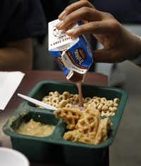 Breakfast at the juvenile center is at 7:15 and is cafeteria-style. Some kids like to drown their cereal in chocolate milk.( Rose Baca  -  Staff Photographer )