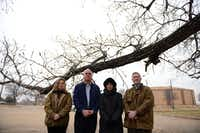 """Coppell residents (from left) Jennifer Holmes, David Bell, Diane Scalley and Patrick Brandt, members of the group """"Stop Kimball Village,"""" stand at the site of the proposed mixed-use building in Coppell. A proposal to build Kimbel Village, a mixed-use building featuring 23 condos and a pediatric office at Kimbel Kourt and Village Parkway, was denied by the Coppell Planning and Zoning Commission in November after a large crowd of residents spoke for several hours about safety, traffic and density concerns.ROSE BACA/neighborsgo staff photographer"""