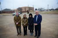 """Coppell residents (from left) Patrick Brandt, Jennifer Holmes, Diane Scalley and David Bell, members of the group """"Stop Kimball Village"""", stand at the site of the proposed mixed-use building in Coppell. A proposal to build Kimbel Village, a mixed-use building featuring 23 condos and a pediatric office at Kimbel Kourt and Village Parkway, was denied by the Coppell Planning and Zoning Commission in November after a large crowd of residents spoke for several hours about safety, traffic and density concerns.ROSE BACA/neighborsgo staff photographer"""