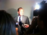 Kingston addresses the media after the meeting.