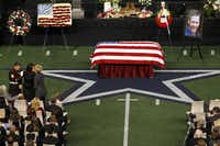 Chris Kyle's flag-draped casket rested on the 50-yard line at Cowboys Stadium. Thousands attended the somber service, paying tribute to the man who was gunned down while trying to help a fellow soldier.