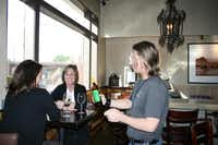 Wine specialist Kyle Sloan (right), talks about the wine selection at Times Ten Cellars with Kim Pinter (left) and Sherry Briggs. Briggs said she has visited the winery since it opened.(Staff photo by ANANDA BOARDMAN - neighborsgo)