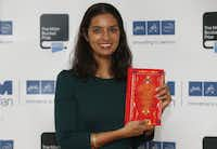 Author Jhumpa Lahiri poses with her book 'The Lowland' in London. Lahiri, Thomas Pynchon, and George Saunders were among the finalists Wednesday, Oct. 16, 2013 for the National Book Awards. A month after releasing long-lists of 10 in each of the four competitive categories, the National Book Foundation announced the five remaining writers for fiction, nonfiction, poetry and young people's literature. Winners receive $10,000 and will be announced at a dinner ceremony in Manhattan on Nov. 20.