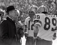 Dallas Cowboys coach Tom Landry talks with quaterback Roger Staubach (12) and tight end Mike Ditka (89) on the sidelines during the 1972 Super Bowl game against Miami in this Jan. 16, 1972 photo, at New Orleans .