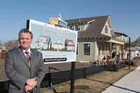 Coppell City Manager Clay Phillips stands next to the first three office cottages in Old Town's Main Street Coppell development.( neighborsgo file photo )