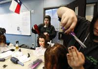 Amanda Rivas, a cosmetology student at Dubiski Career High School in Grand Prairie ISD, styles hair on a mannequin in one of the career classrooms. The school opened in 2009 to offer such specialties as media tech, culinary arts, architecture and engineering.( Mona Reeder  -  Staff Photographer )