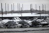 The roof of the boat dock at Pier 121 Marina on Lake Lewisville collapsed under the weight of ice and sleet and knocked boats askew.