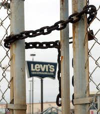 The gate was locked   in 2004 when Levi Strauss  closed a San Antonio plant, the last of its U.S. sewing facilities.(File Photo - The Associated Press)
