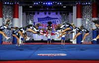 Hebron cheer team members leap above the performance floor as part of their routine at National Cheerleaders Association's high school championship. The Hebron team took first-place honors in their category en route to an undefeated season.Photo submitted by DANIELLE WEBER