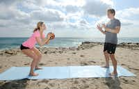 Medicine ball toss. Stand, toss a medicine ball to your partner who will catch, then squat.