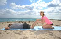 Couple's hamstring and bicep curls: Lie on the floor face down in a line. Your partner kneels at feet and grasps back of your ankles while you raise ankles and feet toward your back with knees on the ground.