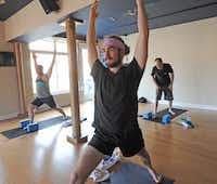 Branson Gates of Haddonfield, Pa., practices yoga steps at Anjali Power Yoga. Men's larger muscle mass requires fine-tuning of exercises.
