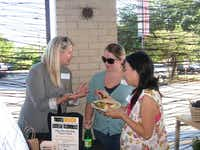 Krista Hartman, left, a founding member of Live Local East Dallas, signs up new members at Whole Foods during a happy hour event.(Photo submitted by MARYBETH SHAPIRO)