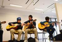 Guitar students (from left) Joel Torres, 10, Jose Christopher Torres, 16, and Edgar Monsivais, 11, practice at La Rondalla. Those who progress to the advanced class can play difficult pieces along with instructors.ROSE BACA/neighborsgo staff photographer