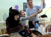 River Morin (left), 7,  and Elise Thornton, 6, played with slime during an after school session at The Lab in Old East Dallas.