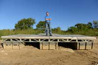 Lake Manager Rob Jordan stands atop the courtesy dock near Oakland Park that has been closed due to low lake levels.