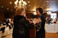 Sen. Jane Nelson announces door prize winners with Nancy Wright, Lewisville Lake Symphony board member, at the annual gala celebrating the organization's 30 years of music.( ROSE BACA/neighborsgo staff photographer )