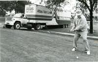 Golfers in this photo from 1987 had to deal with an unexpected obstacle on the edge of the ninth tee box at the Lakewood Country Club Golf Course. A moving van rolled out of the Lakewood Oaks Apartments. The drivers were calling on a person who was moving when the truck rolled400 feet across a street, crashing into a car, through a fence and over some crepe myrtles. No one was injured, and golfer James Peden didn't let it stop his game.(DMN file photo)